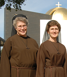 The Franciscan Sisters of the Eucharist, Sister Veronica Schueler, Sister Damien Marie Savino, Sister Mary Roberta Connors and Sister Paula Jean Miller stand in front of the Chapel of St. Basil