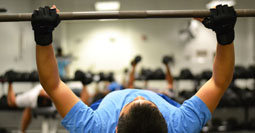 A student in the weight room in Jerabeck Activity and Athletic Center