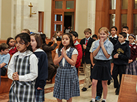 Catholic students process into the UST/Archdiocesan Essay Contest Mass