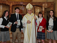 Kathleen Blute of St. Pius X High School, Cameron Kic of St. Thomas High School, Archbishop Joseph A. Fiorenza, Sarah Trumble of Incarnate Word Academy, and Isabel Sutter of St. Agnes Academy