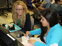 Jessica Reyes, right, helps Anna Loyd with her tax return.