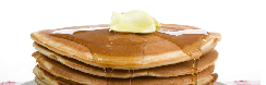 A stack of pancakes covered with butter and syrup