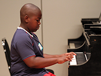 Xavier Smith Plays the Piano