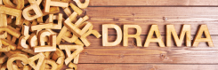 Wooden alphabet spelling the word drama