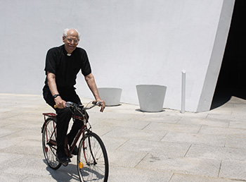 Fr. Patrick Braden, CSB, on a bicycle