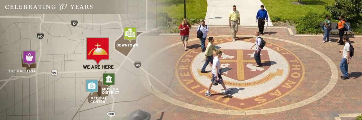 Students walking past campus seal at University of St. Thomas in Houston, TX