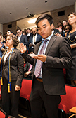 Students reciting the Cameron Pledge at the Cameron School of Business Honors Convocation and Graduation Celebration.