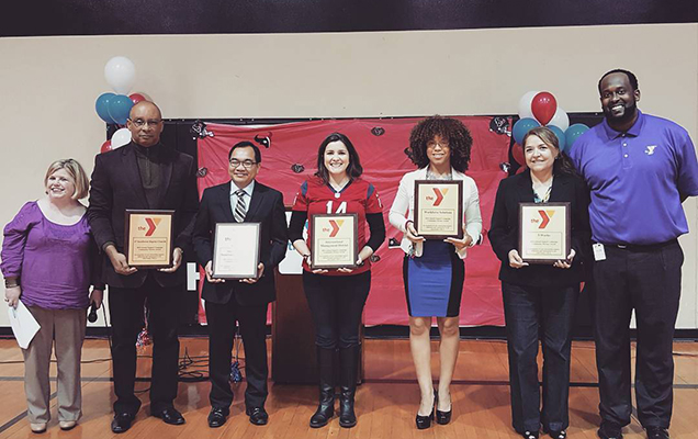 University of St. Thomas – Houston, Texas Master of Public Policy and Administration grad Natali Hurtado receives an award from the Alief YMCA