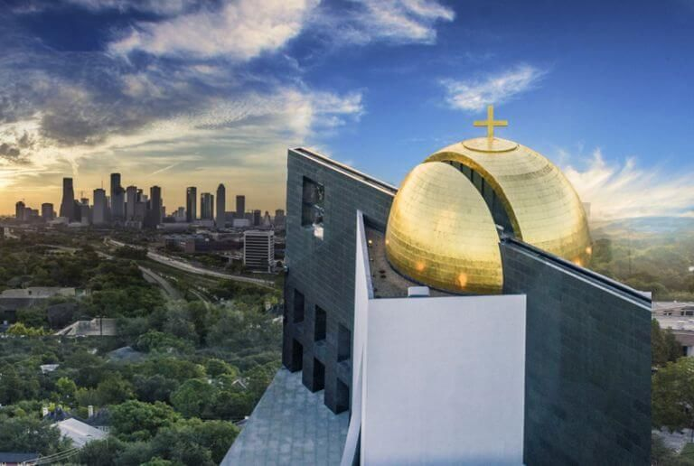 Artist rendering of the Catholic Chapel of St. Basil at the University of St. Thomas looking out over the city of Houston, Texas