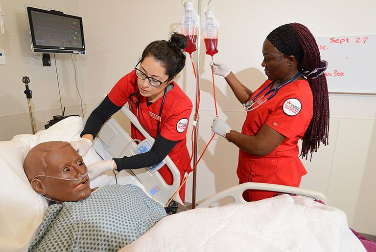 Two students during a nursing school simulation exercise at the University of St. Thomas in Houston, Texas