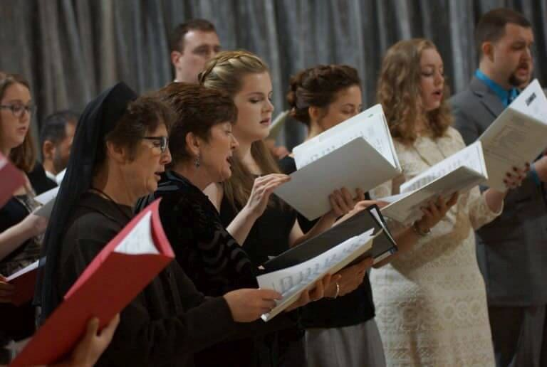 Choir sings during winter graduation at the University of St. Thomas in Houston, Texas