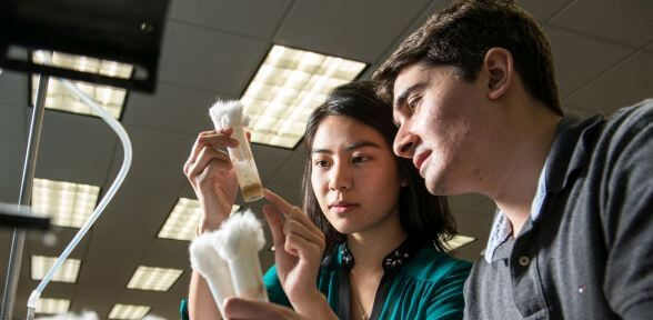 Two female undergraduate STEM students and professor at University of St. Thomas in Houston, Texas