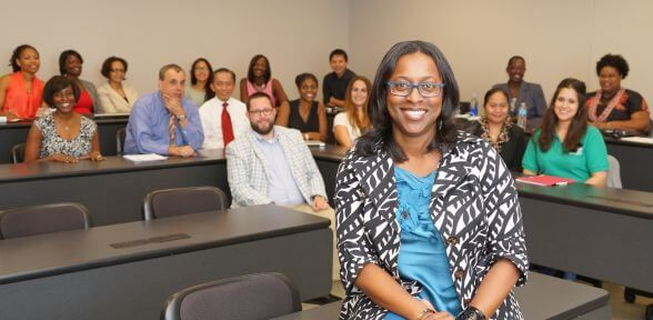 School of Education professor with classroom of graduate students at University of St. Thomas in Houston, Texas