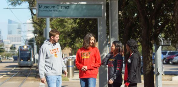 University of St. Thomas students at Metro station in the Houston, Texas Museum District
