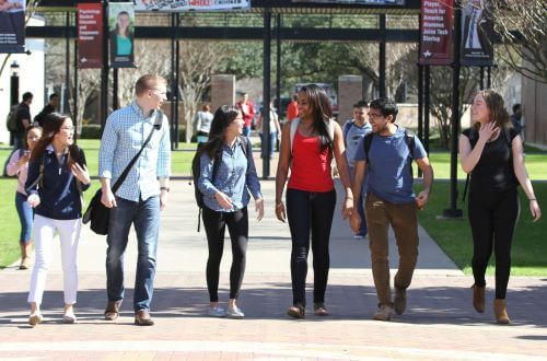 Undergraduate students walking on campus at University of St. Thomas in Houston, Texas