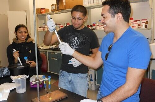 Students conducting physics research in lab - University of St. Thomas - Houston