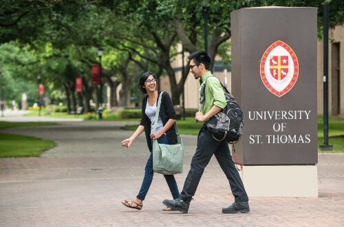Two students walk on the University of St. Thomas - Houston campus