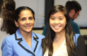 Dr. Beena George, Chair of the Cameron School of Business at the University of St. Thomas - Houston, with student