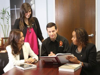MBA graduate students reviewing books at University of St. Thomas in Houston, Texas