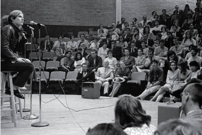Andy Warhol on stage at Jones Hall in the 1960s at the University of St. Thomas in Houston, Texas