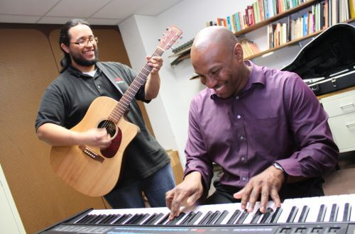Two University of St. Thomas - Houston Music students play piano and guitar