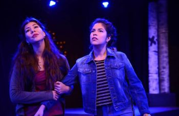 Two female University of St. Thomas - Houston Drama students perform on stage