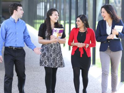 University of St. Thomas - Houston MBA Master of Business Administration students walking on campus