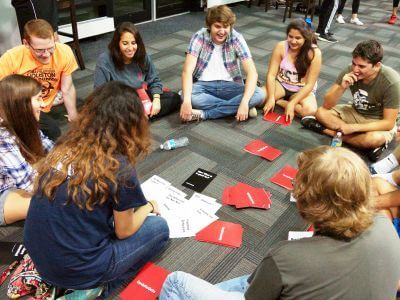 Students playing Cards for Celts in Guinan Hall dorm on campus of the University of St. Thomas in Houston, Texas
