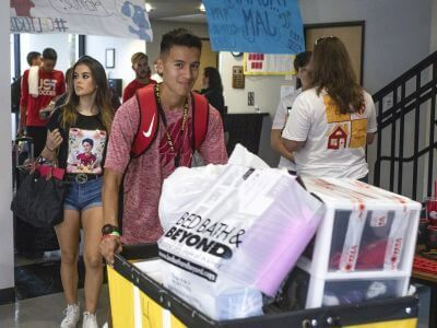 Students moving in to Guinan Hall dorm on the campus of the University of St. Thomas in Houston, Texas