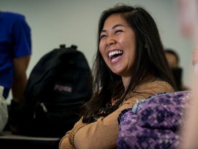 Psychology major laughs during University of St. Thomas - Houston class