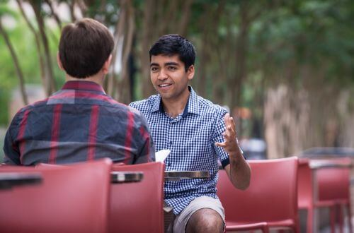 Psychology majors sit and talk on University of St. Thomas - Houston campus