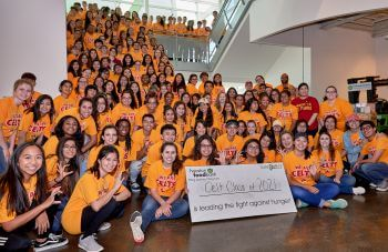 Large group of University of St. Thomas - Houston psychology majors participate in service learning