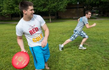 Criminology majors play frisbee on University of St. Thomas - Houston campus