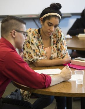 Student getting tutored at University of St. Thomas in Houston, Texas