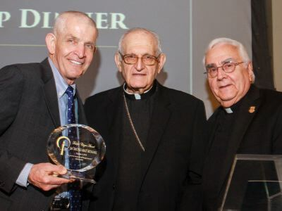 Mattress Mack (Jim McIngvale) accepts faithful citizenship award from Archbishop Emeritus Fiorenza and Fr. Donald Nesti
