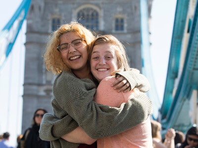 Two University of St. Thomas - Houston students hug during a study abroad trip