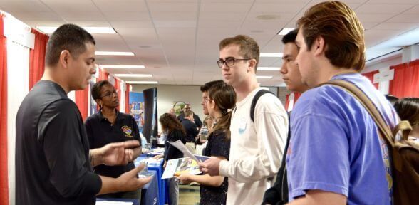 Students at job fairon the campus of the University of St. Thomas in Houston, Texas