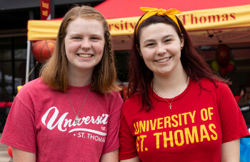 Students in University of St. Thomas - Houston T-shirts on campus