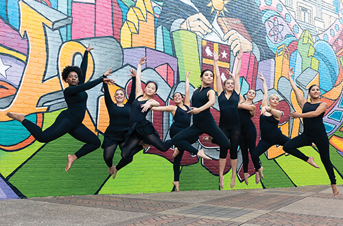 University of St. Thomas - Houston Dance majors practice in front of mural