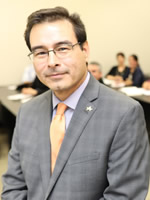 Dr. Adam G. Martinez