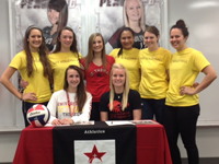 Photo: Current and new UST volleyball players celebrate signing day at Pearland High School