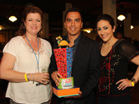 Alumni Jennifer Mengis, Drew Wilson and Kelli Kickerillo presented the trophy at the 2012 Two Saints and a Taco Tasting event.