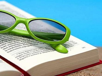 Photo: Green Glasses on Book