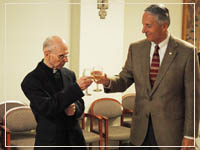 Photo: Fr Brezik Toasting with President Ivany