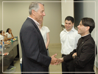 Photo: President Ivany greets Fr. T.J. Martinez, SJ, President of Cristo Rey Prep